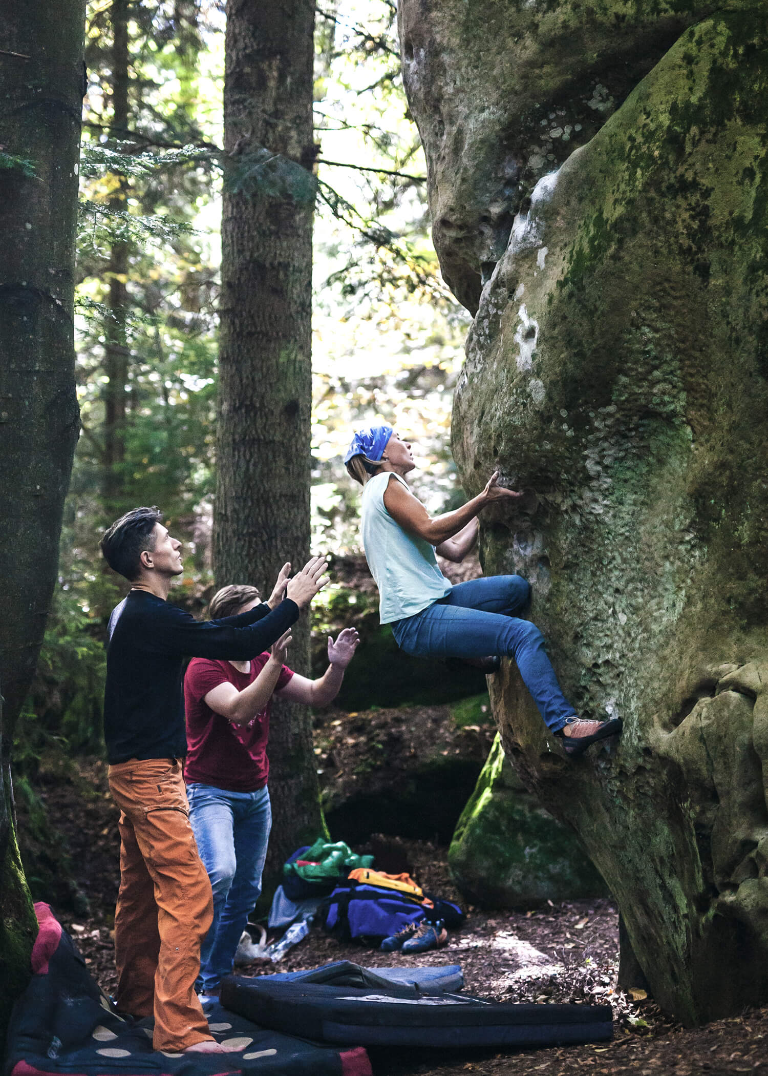 Image of a woman scaling a rock while two people wait to help if she falls. This photo illustrates the support that you can find while working with a DBT therapist in Torrance, CA. The DBT Center of South Bay offers comprehensive DBT programs in Los Angeles, CA. 90266 | 90505