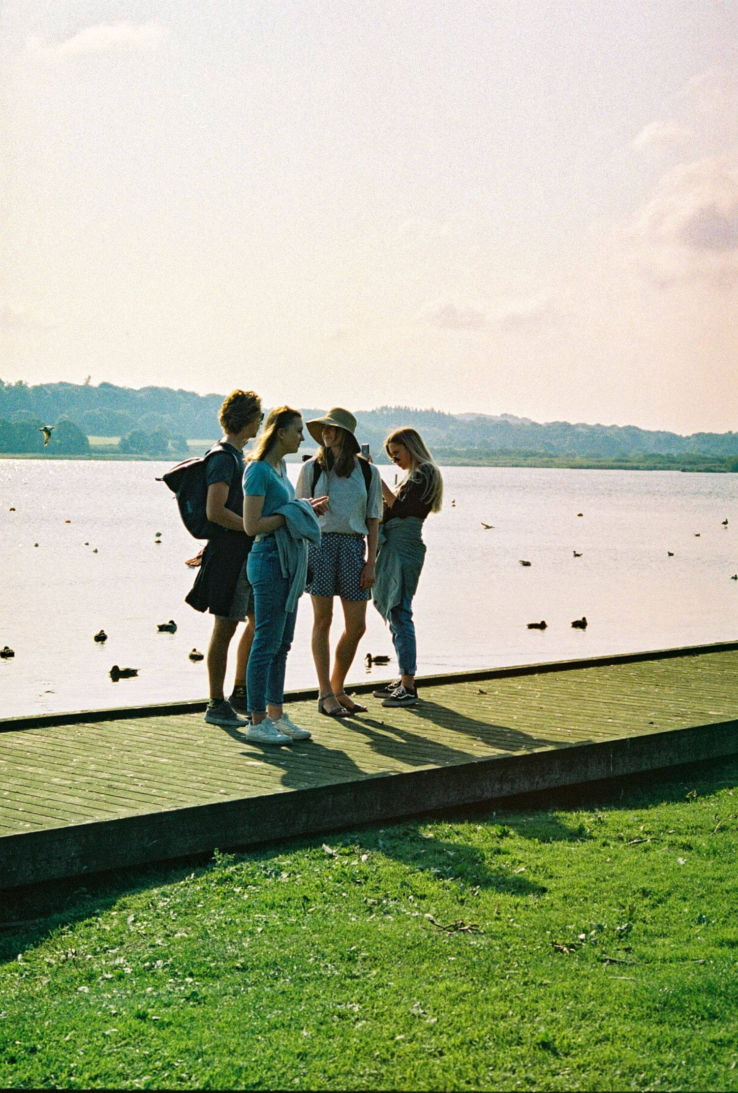 Image of four teenage girls standing on a boardwalk together. Your teen may be encountering challenges for teens, leading to dysfunctional family dynamics in Los Angeles, CA. 90274 | 90275