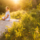Image of a woman sitting on a rock peacefully. This image represents mindfulness skills, which a DBT therapist can teach for those using self-harm in Los Angeles, CA. 90277 | 90254