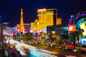 Image of downtown Las Vegas, with lights lit up and car lights blurred as they pass by. This image represents the busy lifestyle lived by those in Las Vegas. Slowing down and starting online therapy can be hard, but DBT therapy in Las Vegas can help. Consider starting Dialectical Behavior Therapy with an online therapist in Las Vegas. 89135 | 89104 | 89011